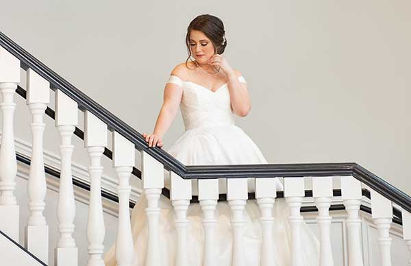 Photo of a bride on a staircase.